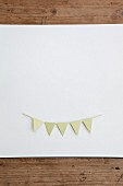 Bunting cut out of paper on white surface