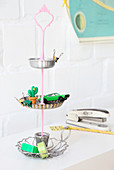 DIY cake stands made from recycled cake tins and candlestick