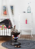 Ethnic ambiance and white cabinet in child's bedroom