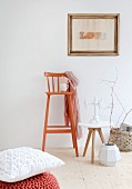 Framed string art, side table and orange retro bar stool