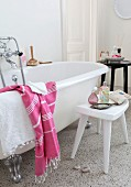 White free-standing bathtub in vintage interior