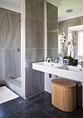 Shower area and white twin sinks in elegant bathroom
