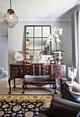 Antique console table and low coffee table in living area
