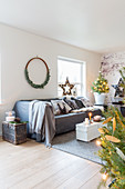 Festively decorated living room in shades of white and grey