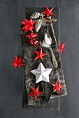 Hand-made Christmas arrangement of various 3D paper stars and origami stars