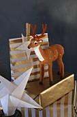 Christmas gifts wrapped in gold paper with stag figurine