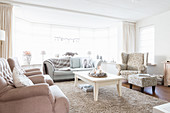 Large bay window in elegant living room in shades of champagne