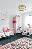 Girl's bedroom in pale pink