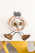 Whimsical figure made from crockery and children's shoes