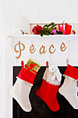 Christmas stockings and a garland of letters by the fireplace