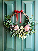 Exotic door wreath made of eucalyptus twig and protea
