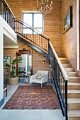 Staircase and brick walls in inviting foyer