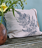 Cushion printed with fern leaf