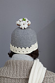 Cotton bolls on top of grey woolly hat with white edge