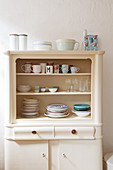 Crockery in old kitchen dresser with open top