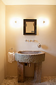 Old sandstone sink in cream bathroom