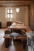 Rustic wooden furniture and wintry decorations in cabin parlour