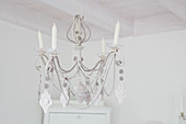 Chandelier with ornaments and decorations made from corrugated cardboard