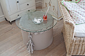 Side table made from corrugated cardboard with glass top in living room