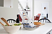 Simply set table in open-plan interior