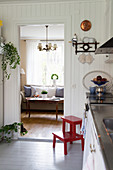 View from Scandinavian country-house kitchen into classic living room