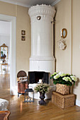 Round, Swedish tiled stove against cream walls