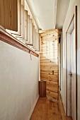 Pivoting wooden door in renovated hall