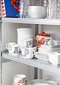 White cups decorated with black shaded letters