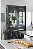 Tall table with industrial-style bar stools in kitchen