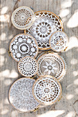 Lace doilies mounted in embroidery frames