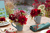 Small autumn bouquets in cups