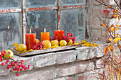 Autumnal candle deco at barn window