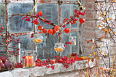 Barn window decorated in autumn, preserving jars as lanterns