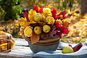 Fragrant autumn arrangement of Chaenomeles, Rosa