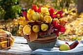 Fragrant autumn arrangement of Chaenomeles, Rosa