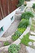 Small sunken garden with walls terraced replaced the light wells