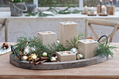 Fast Advent wreath with tealight holders made of wood on tray