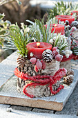 Red candle in birch pot with roses (rosehip), Symphoricarpos