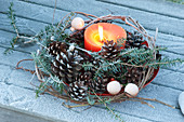 Candle in wreath made of Parthenocissus (wild wine) tendrils