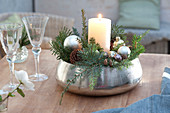 Candle arrangement in silver bowl-white candle, silver Christmas tree balls