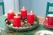 Fast Advent wreath with 4 red candles, cones and gilded apples