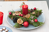 Star of moss and pinus (pine) with red candle