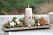 Advent decoration on wooden board crown as a candle holder, stars made of birch bark