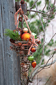 Self made wicker basket decorated with Christmas tree baubles