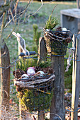 Wire baskets with moss, cones, pinus and silver baubles