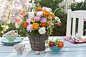Lush bouquet made of ranunculus in basket vase,