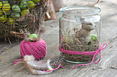 Mini Easter basket in mason jar with Easter bunny, hay and eggs