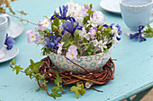 Arrangement in cereal bowl as table decoration, iris reticulata, scilla