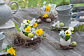 Small bouquets in egg shells as Easter table decoration