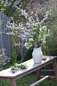 White bouquet of Prunus spinosa and Helleborus branches